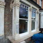 Repairing a bay window including carving new caps